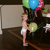 Kate enjoys her helium birthday balloons.