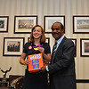 Olympian Katie Ledecky and County Executive Ike Leggett share a light moment over the Ike's picture on a Wheaties Box