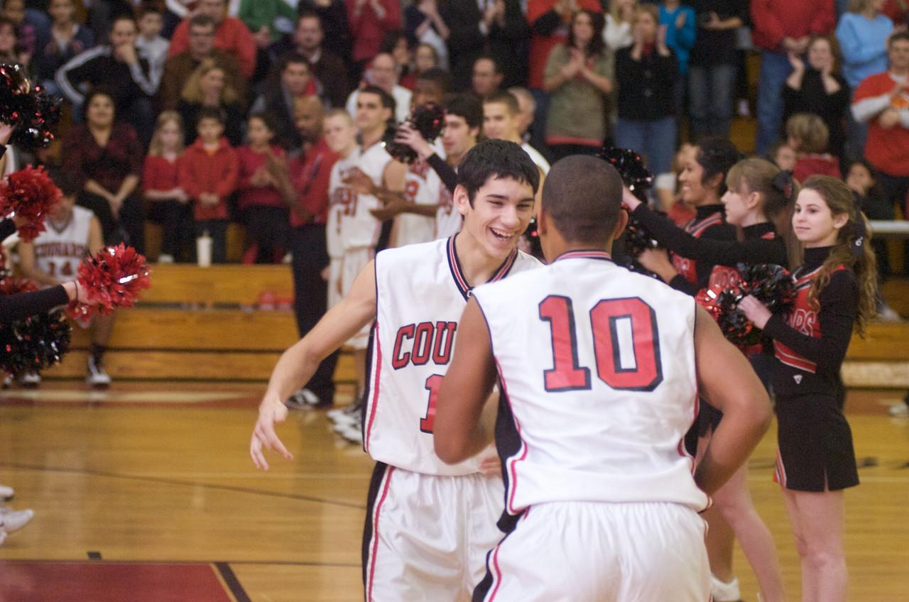 QO vs Rockville BB.  Sr. Matt Ryan is all smiles as the home season begins for the QO Cougars Boys Basketball game.