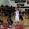 Myck Miller. QO point guard pulls up for a 10 foot jumper against Richmard Montgomery Rockets.