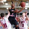 QO #1 Myck Miller point guard drives against Wootten in QO's 4th game of the season. QO won 51 to 48