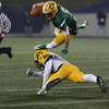 George P. Smith/The Montgomery Sentinel   <br /> Damascus High School's John Allan Furgeson (#9) hurrdles the chop block attempt by Gwynn Park High School's Devin Curry (#2) to gain additional yardage in the State 2A Final game played at Navy-Marine Corps Memorial Stadium in Annapolis on Saturday, December 2, 2017.