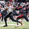 George P. Smith/For The Sentinel   <br /> Quince Orchard High School's Tyler Terry with the stiff arm against the North Point High School defender.