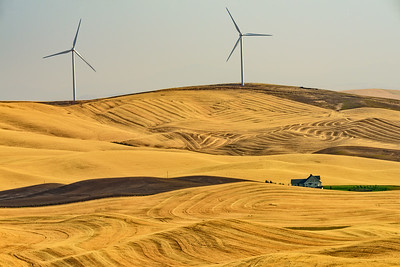 USA, Washington. Patterns, colors,, and wind turbines of the Palouse region at harvest time.