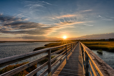 yarmouth Port, MA.  The boardwalk at Grey's Beach at sunrise in autumn.