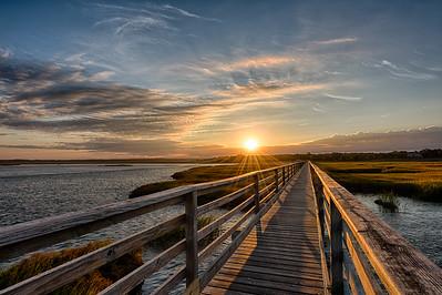 yarmouth Port, MA.  The boardwalk at Grey's Beach at sunrise in autumn.