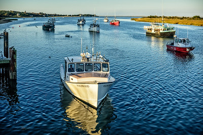 Chatham, MA.  Trawlers  heading in at Chatham Fish Pier in late afternoon.