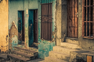Cuba, Trinidad.  A close-up of the colorful  painted homes and doorways on a residential street