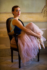 Cuban National ballerina sitting in old Havana Mansion, Cuba