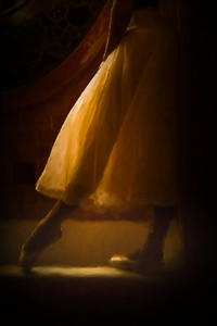 The legs and romantic tutu of Cuban National ballerina standing with light shining through tutu in old Havana Mansion, Cuba