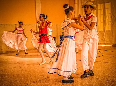 Cuba, Cienfuegos.  Children perform at a community project.