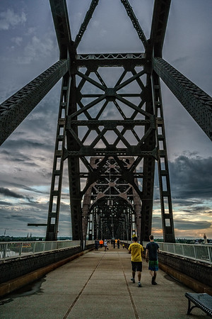 USA, Louisville, KY. Walkers on the George Rogers Clark Memorial Bridge,