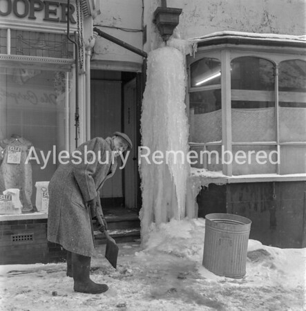 Mr Cheshire clearing ice in Silver Street, Jan 1963