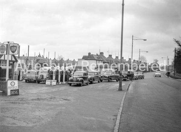 Queueing for petrol at Adams Garage, Dec 5 1956