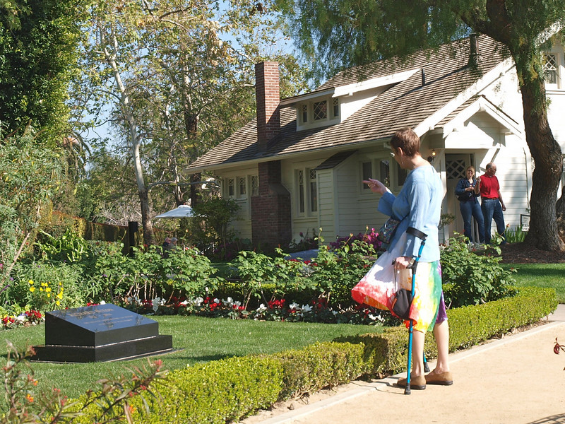 Lesley scolding Richard Nixon's grave at Nixon Library, Yorba Linda, CA March 2009