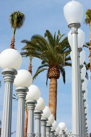 """Art installation """"Urban Light"""" by Chris Burden, which comprises 202 restored cast-iron street lamps, stands on display at the Los Angeles Contemporary Museum of Art in Los Angeles February 8, 2008. A new $56 million wing of the museum, the Broad Contemporary Art Museum."""