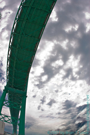 The dramatic green bridge has been designated as the official landmark welcoming visitors to Los Angeles. San Pedro's Golden Gate was the first bridge of its kind to be constructed on pilings. It is designed to withstand winds of 90 miles per hour, double that required by code. The overall length of the bridge is 6,050 feet, with a main suspension span of 1,500 feet and 500-foot spans on either side. The towers are 365 feet high.