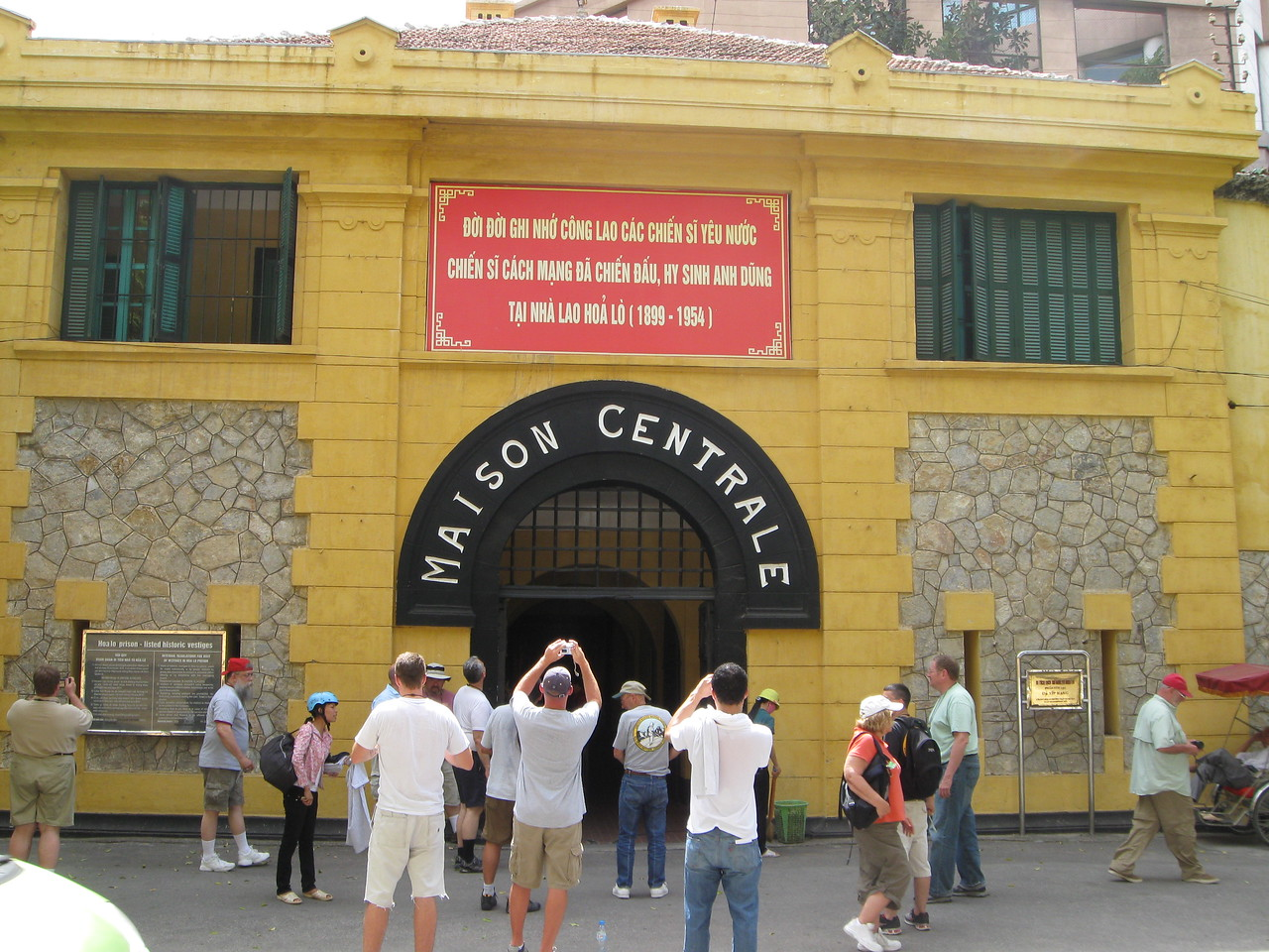 Outside of the Hoa Lo Prison (Hanoi Hilton).  It is now a museum.