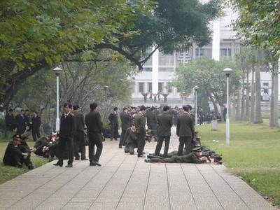 "Vietnamese soldiers during a ""rifle familiarization"" training exercise.  The Ho Chi Minh Museum is in the background."