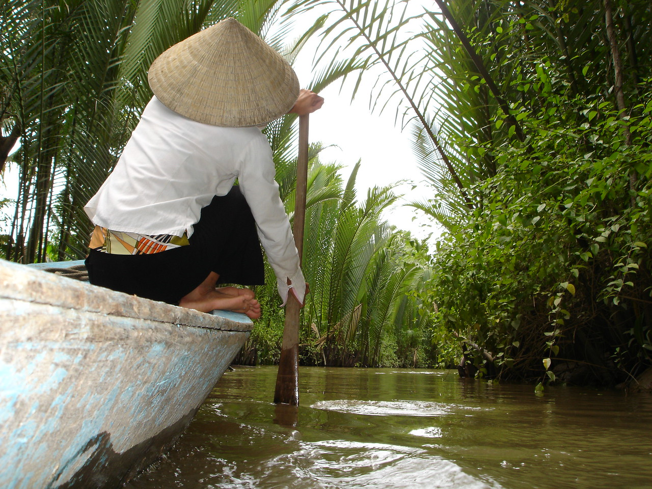 Taking small boat ride through farmland along the south side of the Mekong River.