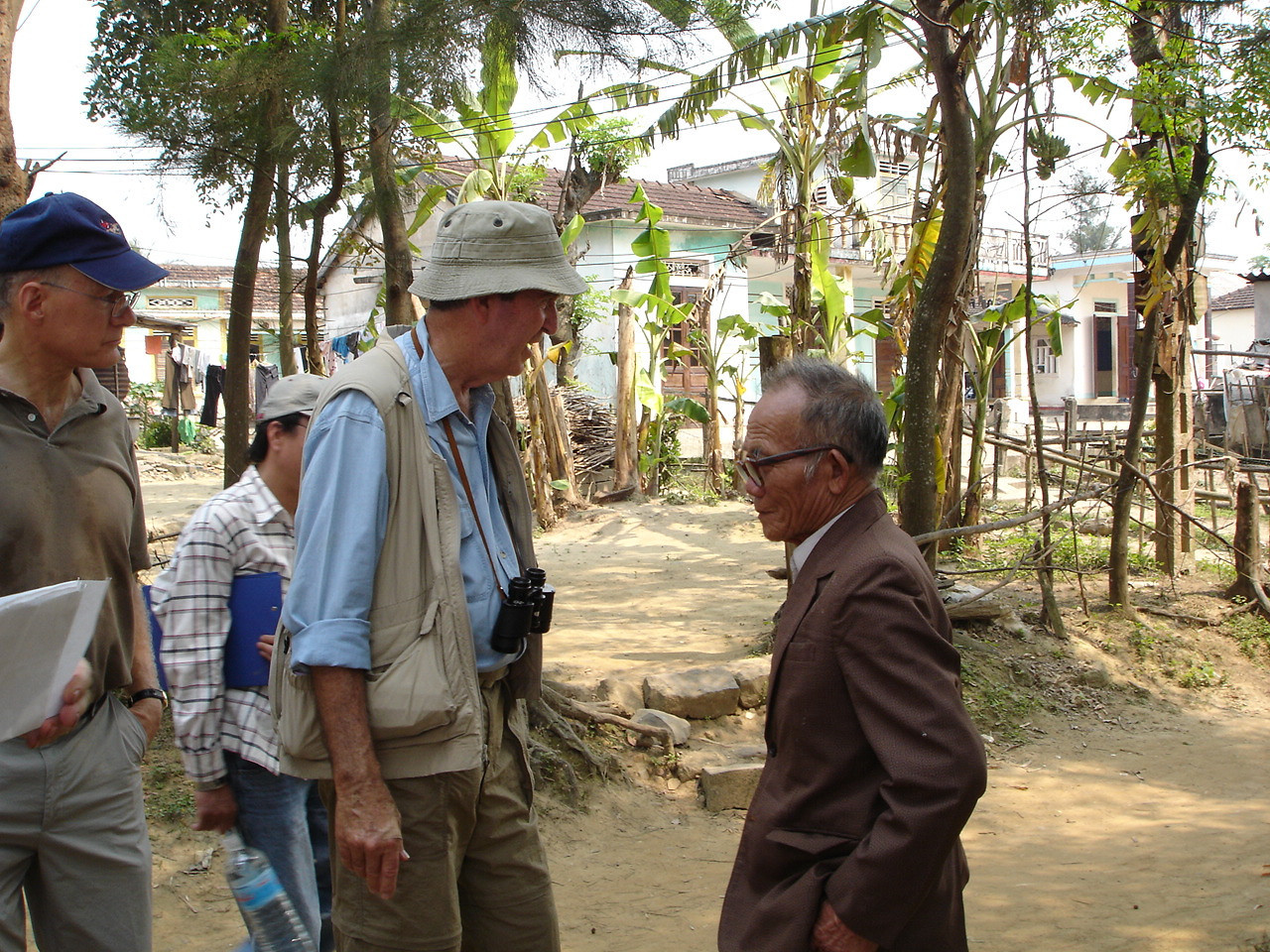 LtCol Martin Johnson (USMC Ret) talks to an old Vietnamese man in the Village of Mai Xa Chanh along the north banks of the Song Cua Viet (River).  They were both here in 1967 and 1968.  -  Tour #VN05031