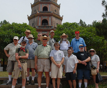 Standing in front of the Thien Mu Pagoda in Hue.  - Tour #VN08061