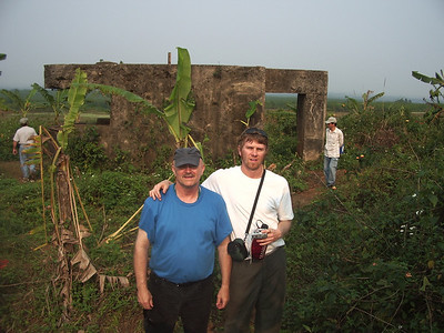 "Mike C. and his son K.C. standing in front of the old French ""fort"" on top of  Con Thien.  -  Tour #VN05031"