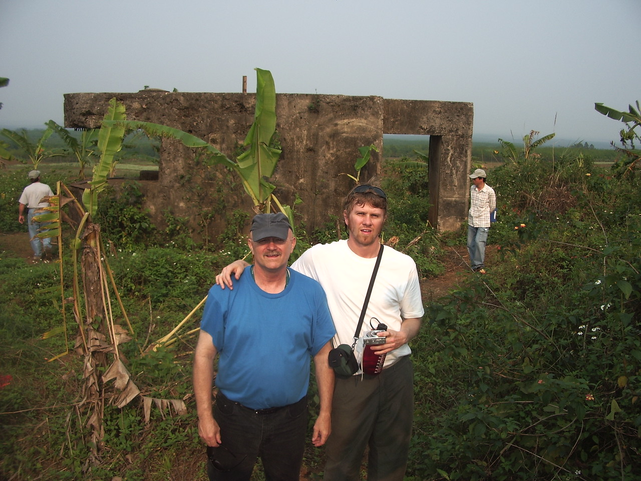 """Mike C. and his son K.C. standing in front of the old French """"fort"""" on top of  Con Thien.  -  Tour #VN05031"""