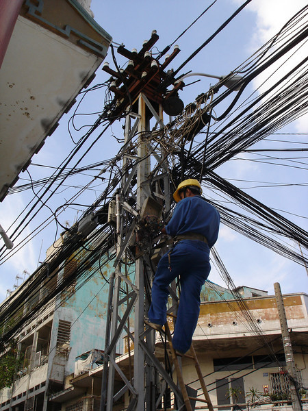 """While watching this guy work, I kept thinking about the Glen Campbell song """"I am a lineman for the county""""."""