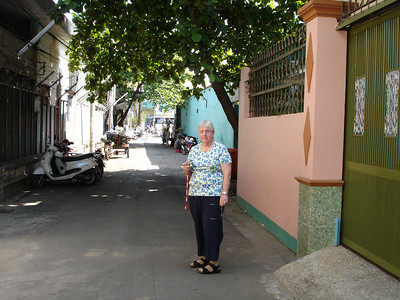 Former U.S. Army Nurse Shelia M. standing outside of a home in Saigon.  This is where she lived when she was stationed at the 3rd Field Hospital in 1968. - Tour #VN09031