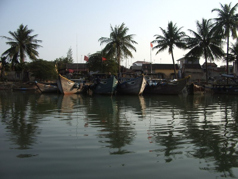 Fishing boats alone the banks of the Hoi An River in Hoi An.