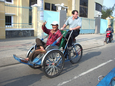 Your VBTours guide Gene Miller driving the cyclo driver around in Da Nang.