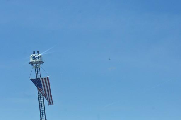 Firemen Preparing the Flag for Flyover