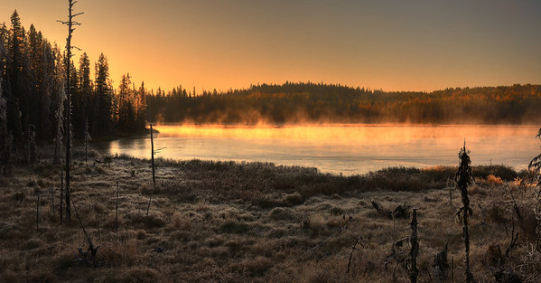 Partly frozen pond and frost at sunrise, between Wells and Quesnel, BC