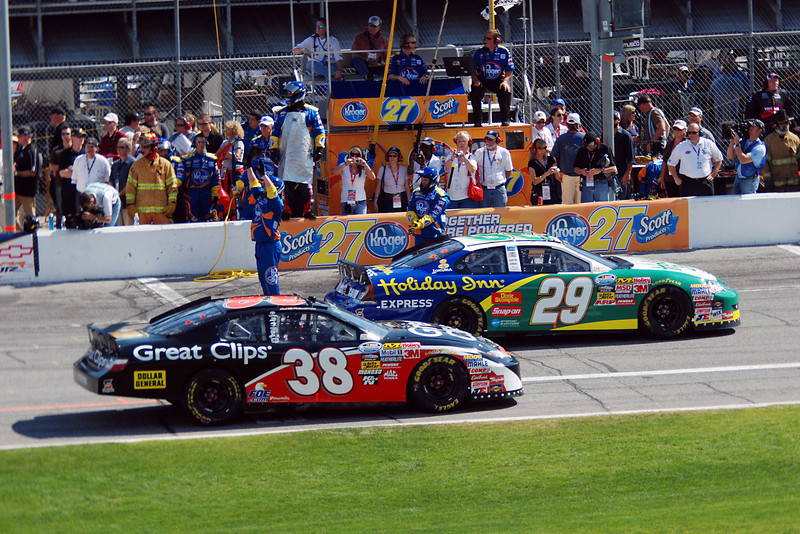 Cars pulling out of pitstop area. - #38, Jason Leffler & #29, Clint Bowyer