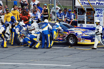 Pit crew working on damaged car
