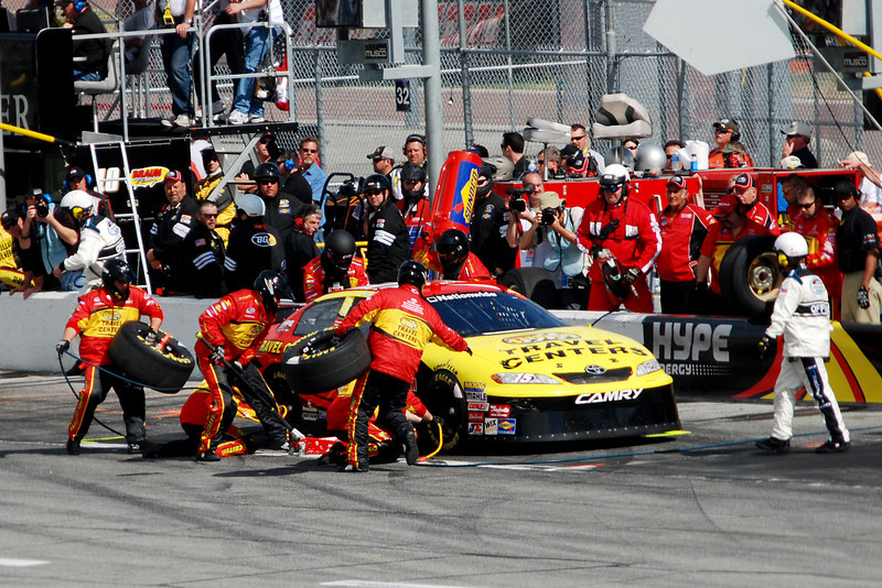#15, Michael Annett - Official watches while the pit crew changes the tires