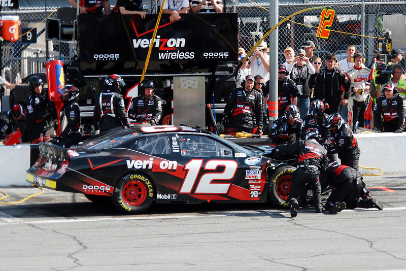 #12, Justin Allgaier - crew working in the pit area after crash