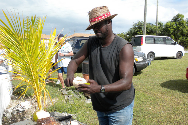 Cutting hunks of coconut for tourists to try