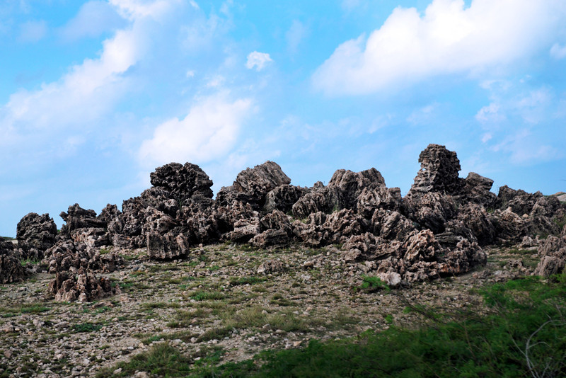 Aruba countryside with sea and volcanic rock formations