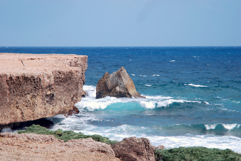 Aruba shoreline with giant rocks, some which have collapsed into the sea.