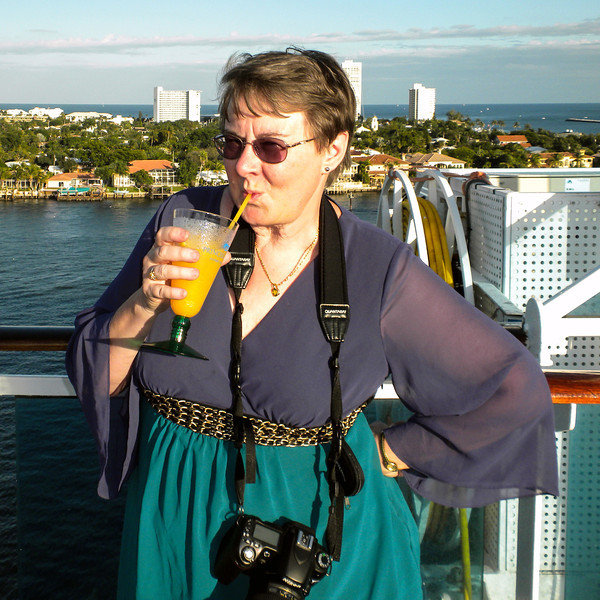Cheryl is not to be left out when it comes to the rum punch drinks, even pausing from taking a few photos
