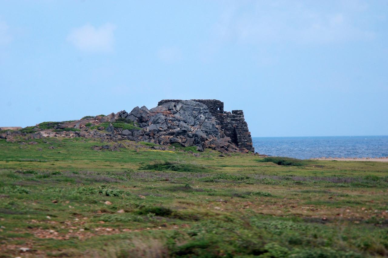 Ruins of an outpost along the Aruba shoreline.