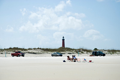 Ponce Inlet beach with lighthouse in the distance.  You are allowed to park on the beach.