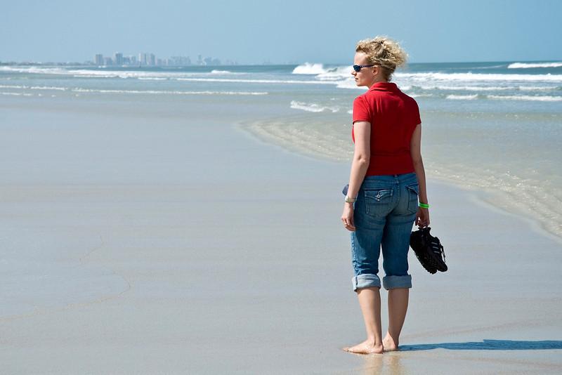 Kathleen enjoying the sand, sea and wind.
