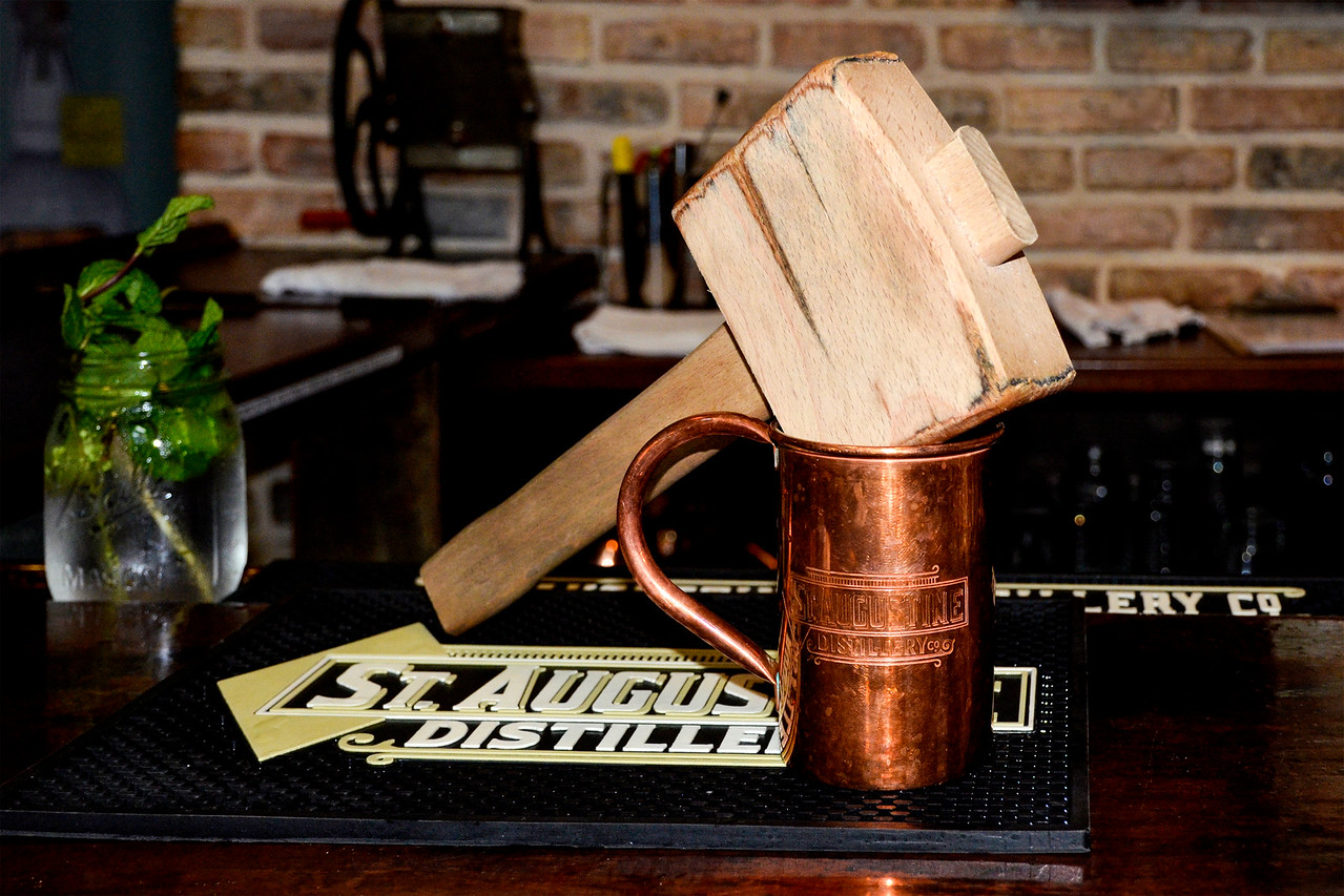 St. Augustine Distillery, copper mug and ice crusher, used in making a Florida Mule