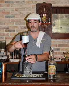 Chip, our guide at the St. Augustine Distillery, making a Gin and Tonic