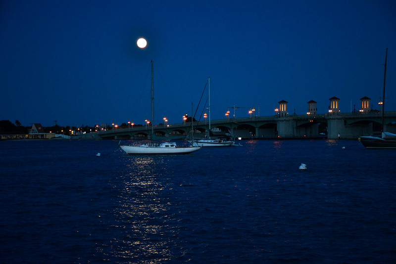 Full moon over the Matanza Bay and the Bridge of Lions.