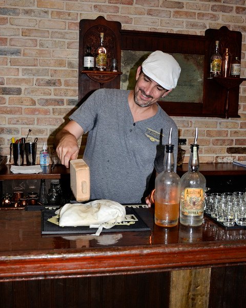 Chip, our guide at the St. Augustine Distillery, crushing ice the old-fashioin way for a Florida Mule