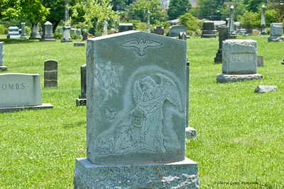 "Some of the ""newer"" headstones had drawings curved into them."